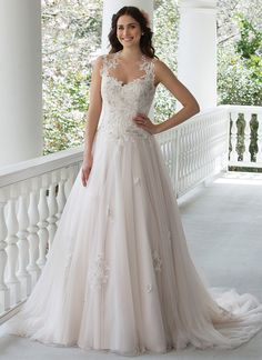 Inspired by princesses, this gown features beaded embroidered lace, illusion straps and back, lace appliques scattered throughout the skirt and a chapel length train. https://www.sincerity.de/brautkleid/3937