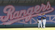 Opening Day 2012: Texas Rangers starting pitcher Derek Holland, left, and starting pitcher Yu Darvish of Japan, warm up in the outfield before a baseball game against the Chicago White Sox Friday, April 6, 2012 in Arlington, Texas.