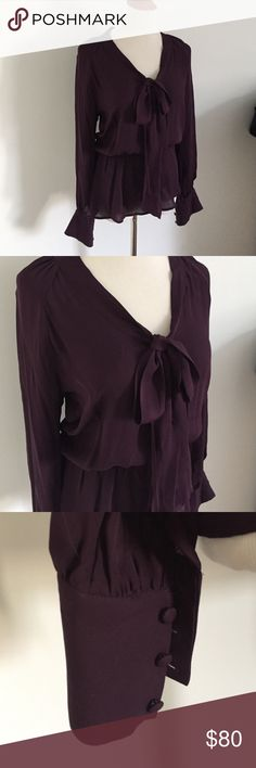 Dark Purple Cabernet Silk Poets Blouse. Slightly sheer and romantic with a tied neck and three button sleeves. Gathered waist. Small tear shown in last pic that cant be see when the blouse is on. 100% Silk from Scoop NYC. Scoop NYC Tops Blouses