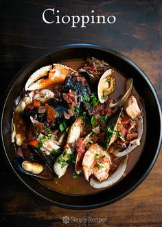 San Francisco-style cioppino Italian fish stew, with fresh halibut, sea bass, Dungeness crab, shrimp, clams, mussels, and oysters in a savory tomato-based broth. On SimplyRecipes.com