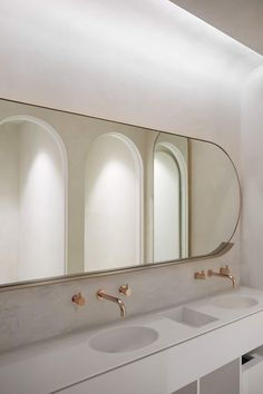 A Minimal Spa and Retreat That Features Archways and Plastered Walls