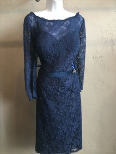 Lace dress. Pictured in Navy. Available in 24 colors.
