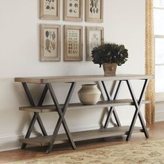 Build an easy and sleek console table for your home. Free DIY plans for this double X console table.