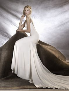 OLALDE | Eternity Bridalwear Distinguished mermaid wedding dress with bateau neckline, fitted to the hips. A magnificent creation in crepe with lovely straps embellished with gemstone motifs.  #wedding #embellished #gemstone #Eternity  #bride #happy #happiness #unforgettable #love #forever #weddingdress #weddinggown #designer #bridalwear #pronovias #pronoviasbrides
