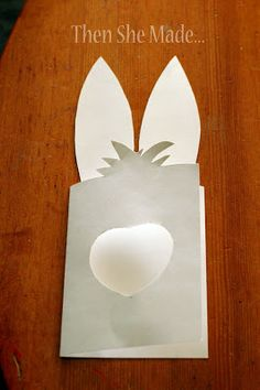 Easter Card-Next, fold the paper back into card shape and carefully cut out bunny ears on the back part of your card.