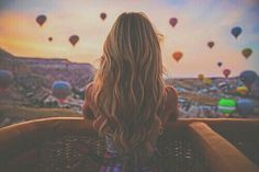 A girl looking out of a hot air balloon with gorgeous hair! Filtered by PastelAngel101™