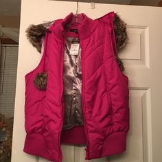 Puffer vest with fur hood Rue 21 puffer vest with removable fur hood. Brand new with tags. Just noticed spot on back as well, see last pic. Rue 21 Jackets & Coats Vests