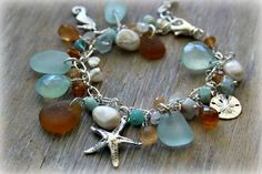 Sea Glass Charm Bracelet with Sand dollar, Starfish , and Seahorse Charms. $79.00, via Etsy. #seaglass