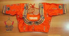 Beautiful orange color designer blouse with pair of elephants hand embroidery design.  20 September 2017