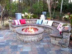 Love the curved bench by the fire pit.