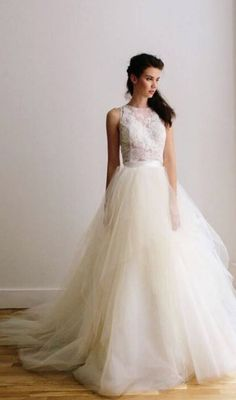 Wedding hairstyle idea; Featured Dress: Lea-Ann Belter
