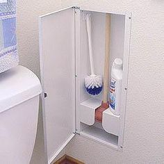 In-wall, between-stud storage for bathroom cleaning items. This is a great idea! I hate seeing them next to our toilet!
