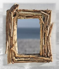 DIY... Driftwood picture frame...except I could use scraps from my woods instead