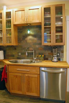 Red birch cabinets with a slate tile backsplash: nice and earthy