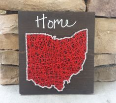 9.5 x 8.5 wood board with state outline. Red string. Can be customized for any state! Includes picture hanger attached on the back All signs