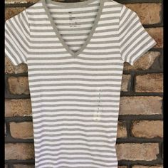 Gray striped V-neck -SEE DESCRIPTION FOR SALE Gap Tee Shirt, Gray & White Striped V-Neck, Short Sleeves. New, never worn. ‼️‼️BUY 2 or MORE AND SAVE‼️ ... I also have this top in XS & M GAP Tops