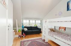 Attic Apartment Decoration 12 - white kids room with bunk bed and black couch