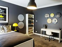 The Bedroom Designs, Captivating Black Wall Painting Teen Boys Room Design With Minimalist White Desk And White Wooden Bookshelf Also Yellow Desk Lamp Cool And Brown Shag Wall To Wall Carpeting: Let's Design a Charming Room For Your Teenage Boy