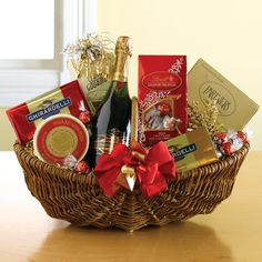 Have to have it. The Sparkler Wine Gift Basket $79.95. This elegant gift basket contains everything for the discerning recipient, including Domaine Saint Michele champagne, chocolate truffles, two Ghirardelli chocolate bars, toasted sesame crackers, cheese, and snack mix.