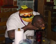 A man and a burger: | The 35 Most Disturbing Face Swaps Of All Time