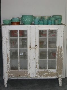 I love vintage glass door cabinets, can't get enough of them.