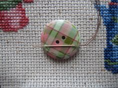 Never lose a needle again! This beautiful green/pink plaid needle minder is made with wooden buttons and strong magnets! The back magnet has Needle Minders, Magnets, Strong, Plaid, Buttons, Green, Pink, Etsy, Beautiful