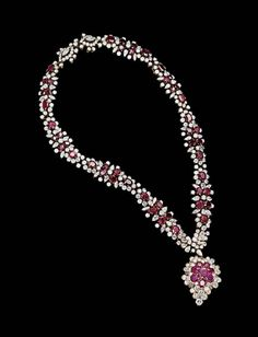 A ruby and diamond necklace, by m. Gérard, and a ruby and diamond pendant, by Van Cleef & Arpels #christiesjewels