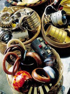 Storage becomes a design feature with baskets of bangles in Loulou de la Falaise's Parisian apartment