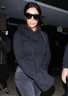 Honoree: Kim Kardashian looked casual in dark shades and hoodie on Monday as she arrived a...