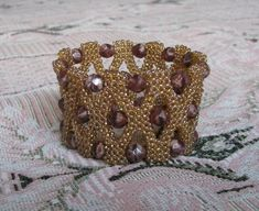 бисер квадратный жгут: 2 тыс изображений найдено в Яндекс.Картинках Beaded Bracelets, Pearl Bracelets, Seed Bead Bracelets, Pearl Bracelet