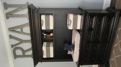 Great space saver. Dresser and changing table with storage above all in one.