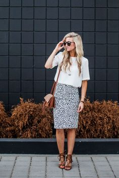 fbbfd21a2a All seasons style Dalmatian Print Skirt + Lace Up Sandals with a brown  crossbody bag.