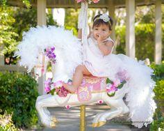 First birthday photography. First birthday photo shoot ideas. Baby girl photo ideas. Horse carousel photo ideas. 1st birthday outdoor photography. Miami Florida photographer. InesLynn Photography.