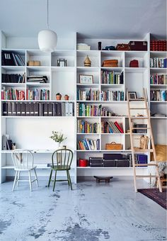 "Bookshelves system from floor to ceiling - a whole wall becomes one furniture. Reach the top with a small ""library ladder""."