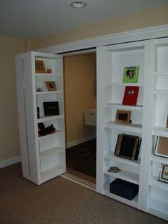 Bookshelf closet doors — HOW is it possible I never thought of this? Bookshelf closet doors — HOW is it possible I never thought of this? Bookshelf Closet, Bookcase Door, Closet Storage, Office Bookshelves, Door Shelves, Closet Bed, Bookshelf Wall, Hallway Closet, Storage Sheds