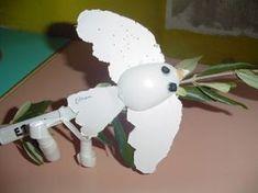 Lavoretto di Pasqua semplice - Colomba di cartoncino con ramoscello di ulivo.