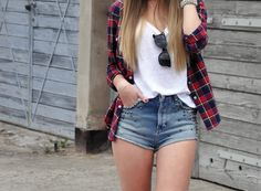 High waisted jeans with a white tee slightly tucked into the jeans and plaid