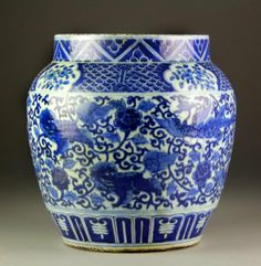 """Chinese Ming Style Blue & White Porcelain Pot Finely painted in the Ming style to depict peacocks and foo lions amongst lotus blossoms and scrolling tendrils, the body having six character Jiajing mark in blue, 14.25""""H X 13.5""""D, circa late 19th/early 20th century."""