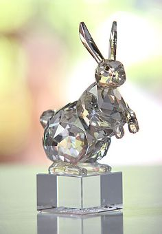 """Swarovski Zodiac Rabbit   $300.00 4 5/16""""   Item# 1046179        To celebrate the year of the rabbit in 2011, Swarovski is extending the Chinese Zodiac collection with this magnificent new piece. Considered an intelligent and quiet animal, the gentle rabbit represents peace, stability and tranquility.  Skillfully captured in faceted and unfaceted Silver Shade crystal, this stunning sculpture impresses with its authentic Asian design. The name of the Zodiac in English and Chinese seal…"""