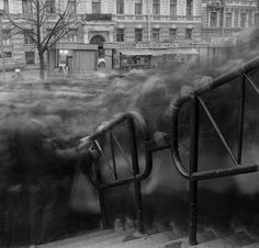 Creepy long-exposure shots in St. Petersburg, Russia turns people into ghosts.