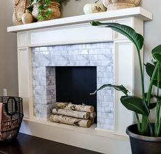 No fireplace? No problem! Check out how you can make your own renter-friendly DIY faux fireplace with peel and stick tiles available at The Home Depot!