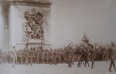 Thai soldiers of the Siamese Expeditionary Force pass under the Arc De Triomphe during the World War I Paris Victory Parade, 1919.