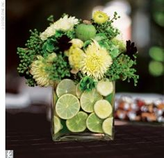 A vibrant tropical centerpiece, cleverly made with limes.