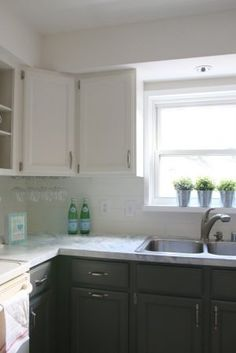 fixer upper inspired kitchen updates using paint!! and this faux shiplap backsplash is made out of peel 'n stick vinyl tiles for $20! all updates for about $300 - wow....