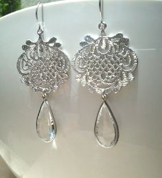 Crystal dangle earring, Silver filigree pendant and silver framed concave cut drop earring, Sterling silver earwire. $22.99, via Etsy.