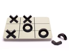 A reflective tic-tac-toe. Those are only half shapes, which reflect from the surface to create whole shapes.