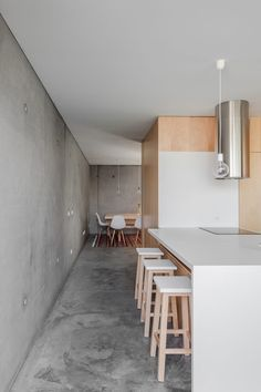 This modern minimalist home combines simple materials (concrete, stone and glass) into a stylish and energy efficient residence