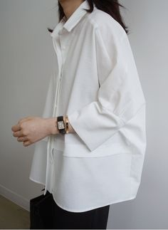 Contemporary Fashion - classic white shirt reinvented with soft cocoon silhouette