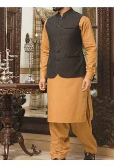 new black waist coat with orange kurta shalwar men eid kurta shalwar kameez and waistcoat dress designs 2017 by Junaid Jamshed Waistcoat Designs, Mens Kurta Designs, Nehru Jacket For Men, Nehru Jackets, Mens Indian Wear, Indian Groom Wear, Black Waistcoat, Men's Waistcoat, Junaid Jamshed Clothing