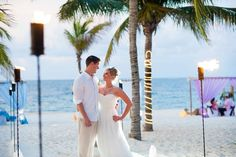 Love the torches in the #BeachWedding set-up!  Destination wedding at Excellence Riviera Cancun.